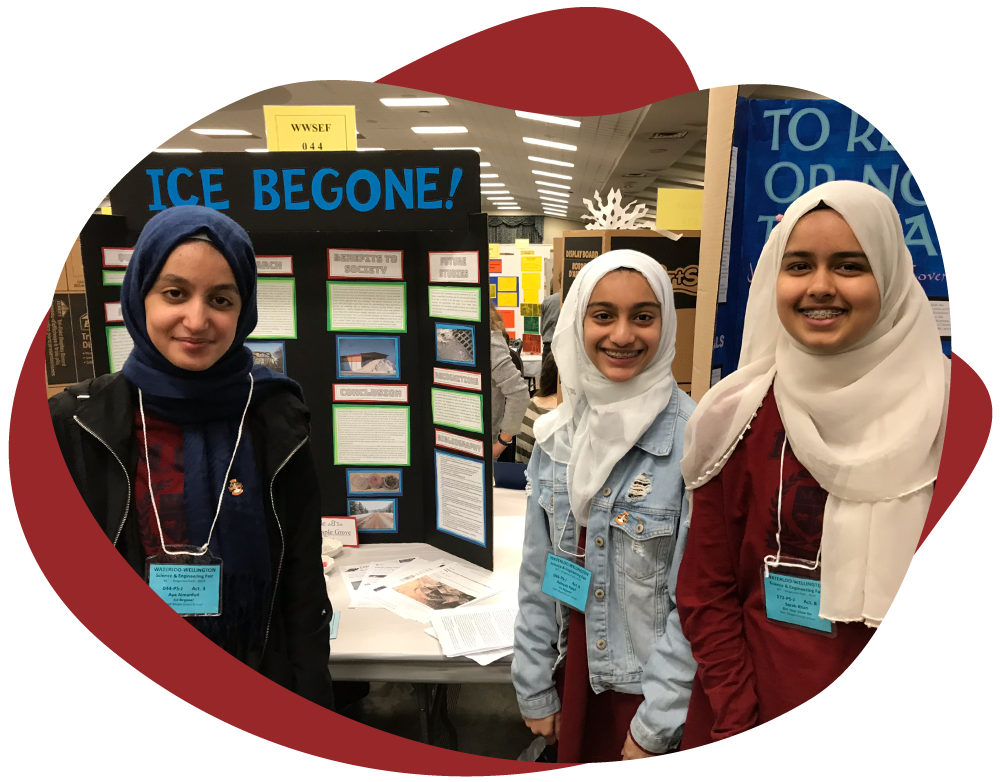 Science Fair Exhibitors with their Project Board