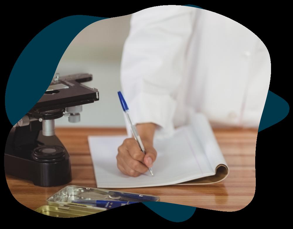 Scientist Writing in Journal